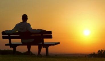 Man-Sitting-on-Bench-at-Sunset-620x330